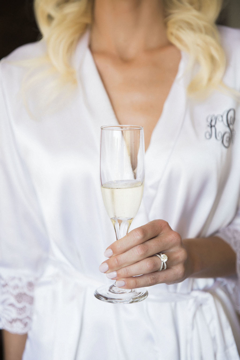 Bride Getting Ready Portrait in Monogrammed White Silk Robe with Champagne Glass | Tampa Bay Wedding Photographer K&K Photography