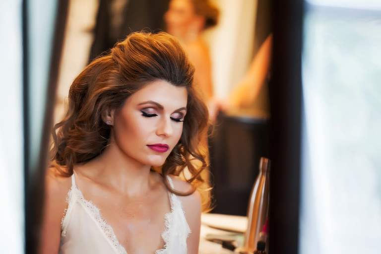 Bride Getting Ready Portrait with Purple Eyeshadow and Magenta Lips