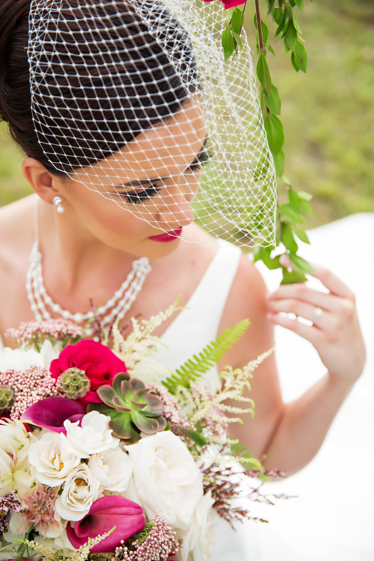 Outdoor Bridal Portrait in Birdcage Veil with Triple Strand Pearl Necklace with White Rose, Magenta and Fuschia Flower, Succulent and Fern Greenery Bouquet | Tampa Bay Wedding Hair and Makeup Michele Renee The Studio | Wedding Florist Gabro Event Services | Bridal Shop Truly Forever Bridal