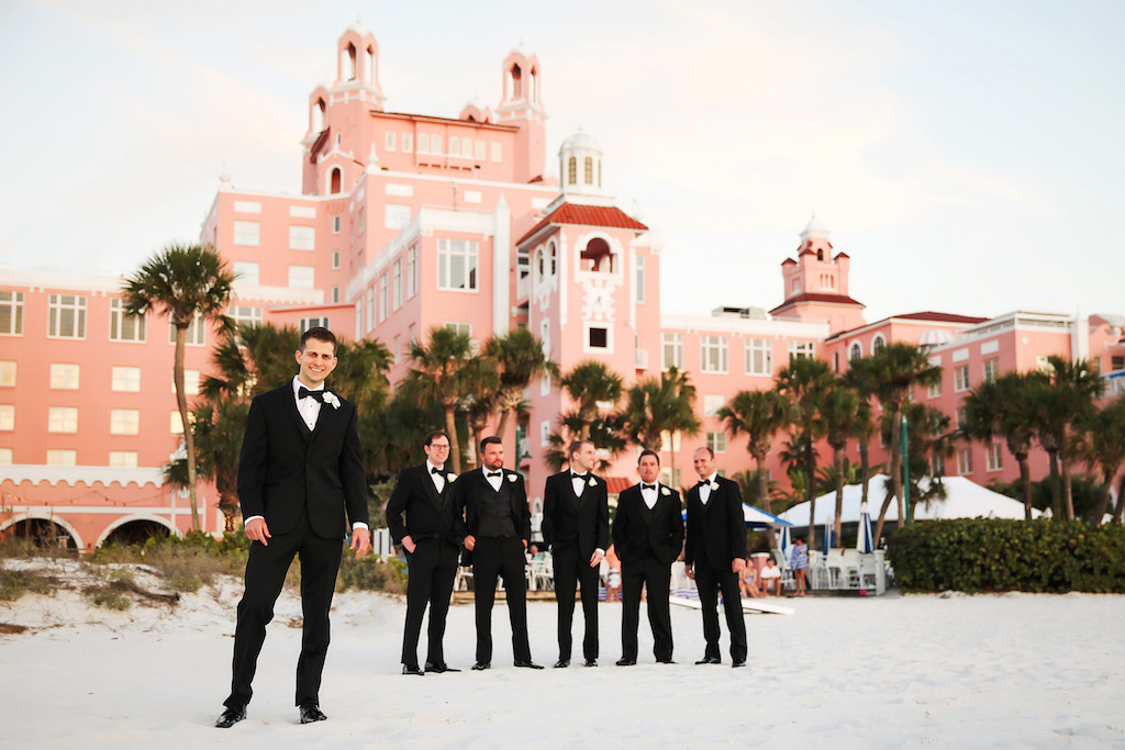 Groom and Groomsmen Wedding Party Outdoor Beach Portrait in Black Tuxedoes   St Pete Beach Historic Hotel Wedding Venue The Don Cesar