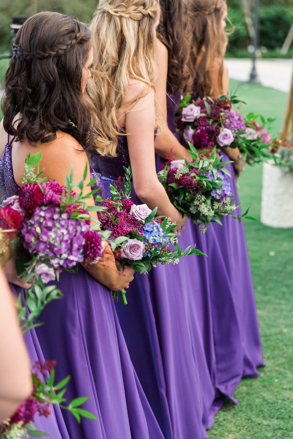 Whimsical Violet Wedding Ceremony Bridesmaid Portrait in Floorlength Jasmine B2 Dresses with Magenta, Purple, and Tropical Greenery Bouquets