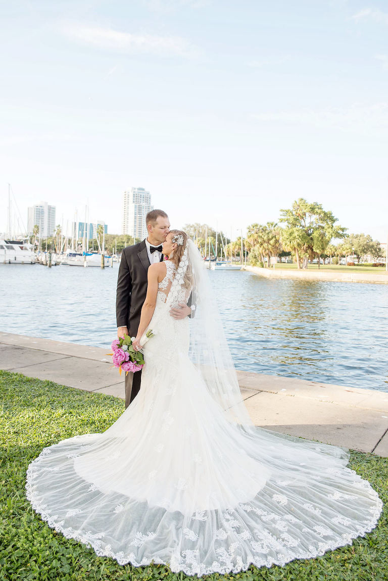 Outdoor Waterfront Bride and Groom Wedding Portrait with Pink Peony with Greenery Bouquet and Long Vintage Wedding Veil | St Pete Wedding Photographer Kristen Marie Photography
