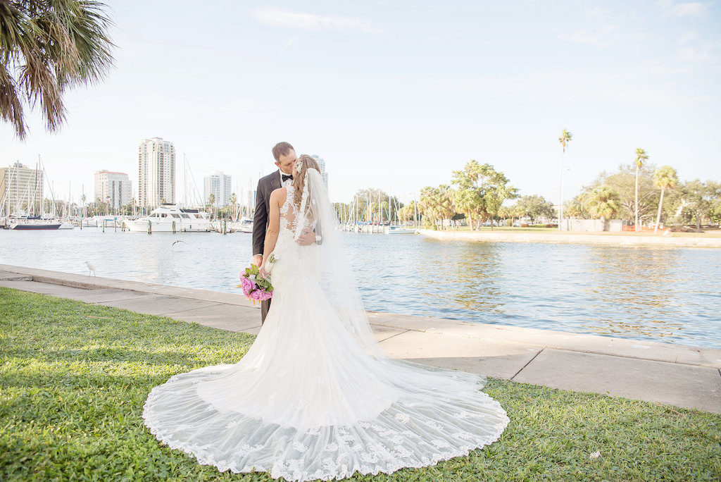 Outdoor Waterfront Bride and Groom Wedding Portrait with Pink Peony with Greenery Bouquet and Long Vintage Wedding Veil | St Pete Wedding Photographer Kristen Marie Photography | Historic Downtown St Pete Outdoor Wedding Ceremony Venue The St Petersburg Museum of Art