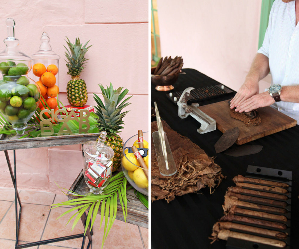 Outdoor Courtyard Old World Havana Cuban Inspired Wedding Reception Cigar Bar with Tropical Fruit, Palm Fronds, and Pineapple in Glass Jars, and Cigar Roller