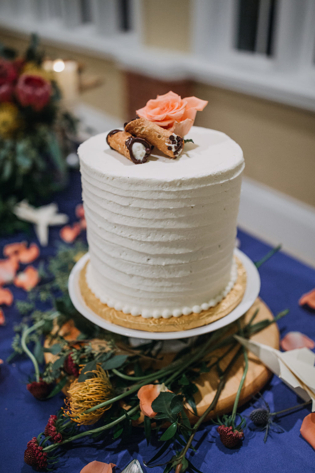 Single Tier Round White Wedding Cake with Mini Cannoli and Pink Rose on Gold Cake Stand