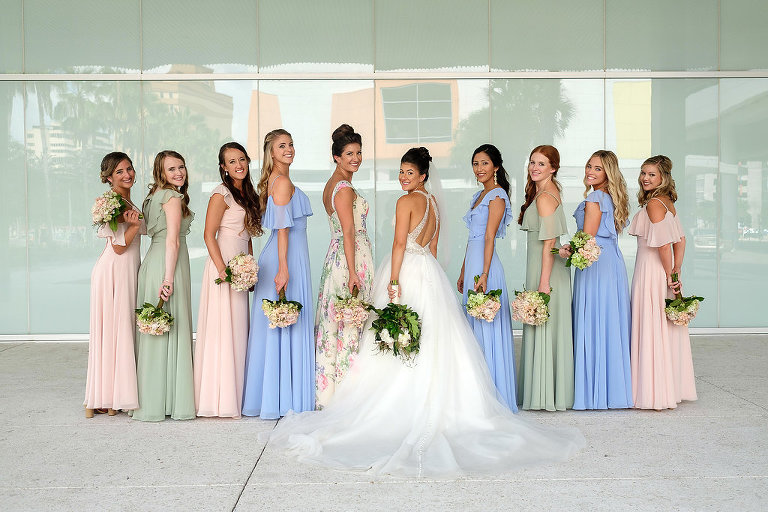 Outdoor Bridal Party Portrait, Bride in Cross Back Ballgown Madeline Gardner Wedding Dress with White Floral Bouquet with Greenery, Bridesmaids in Mismatched Morilee Bridal Dresses in Pink, Blue, and Sage Green, and Pink and Green Floral White Maid of Honor Dress | Tampa Wedding Photographer Marc Edwards Photographs