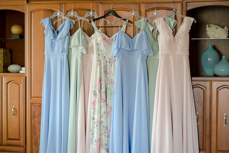 Morilee Bridal Mismatched Empire Waist Bridesmaids Dresses in Sage Green, Light Blue, Blush Pink, and White and Pink Floral Maid of Honor Dress
