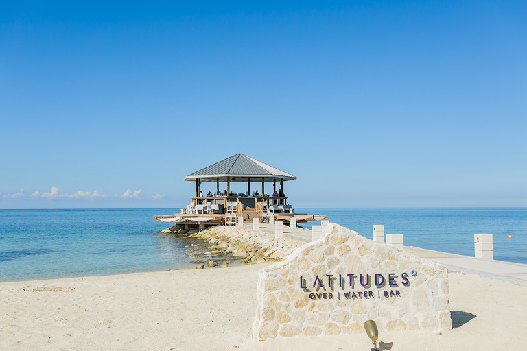 Sandals South Coast Jamaica Destination Caribbean Wedding and Honeymoon Overwater Latitudes Beach Bar | Alexis June Weddings