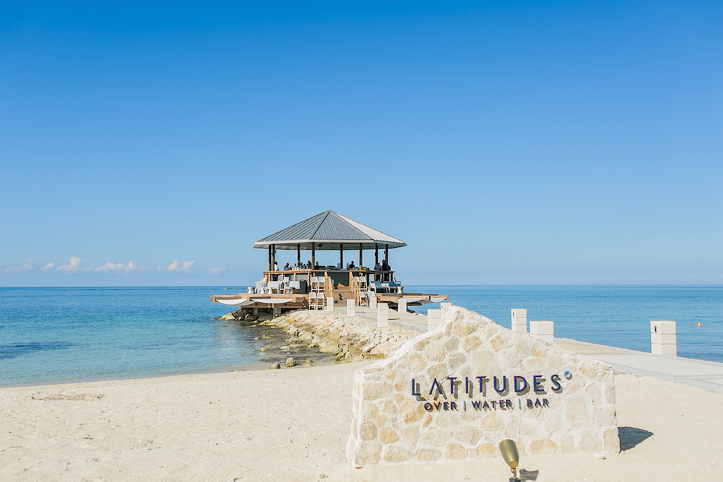Sandals South Coast Jamaica Destination Caribbean Wedding and Honeymoon Overwater Latitudes Beach Bar | Alexis June Weddings