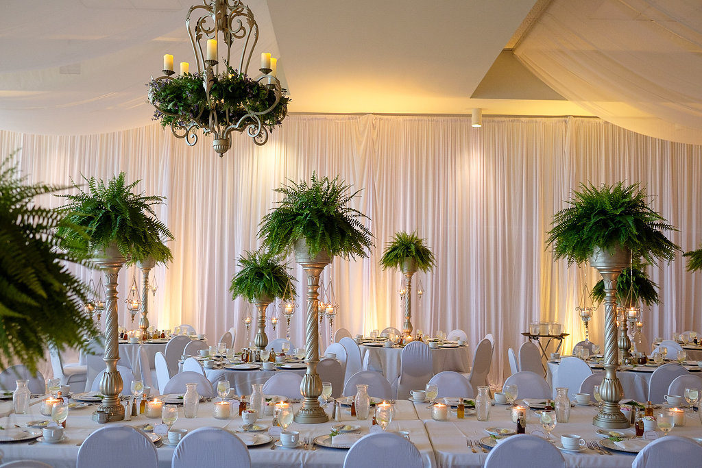 White and Greenery Wedding Reception with Feasting Table and Tall Fern Centerpieces in Gold Pillar Vases with White Draping | Wedding Rentals & Decor Gabro Event Services