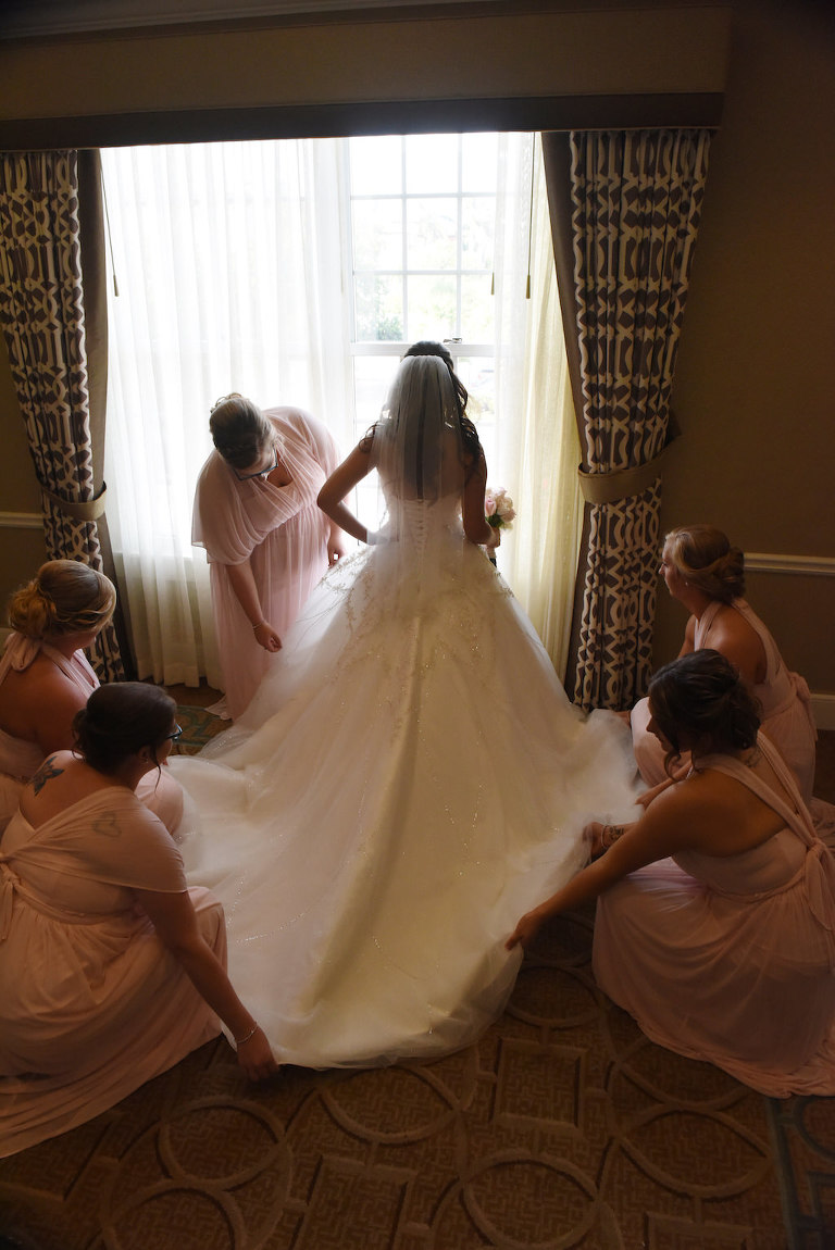 Interior Bride Getting Ready Portrait in Long Train Wedding Dress, Bridesmaids in Mismatched Blush Pink David's Bridal Dresses