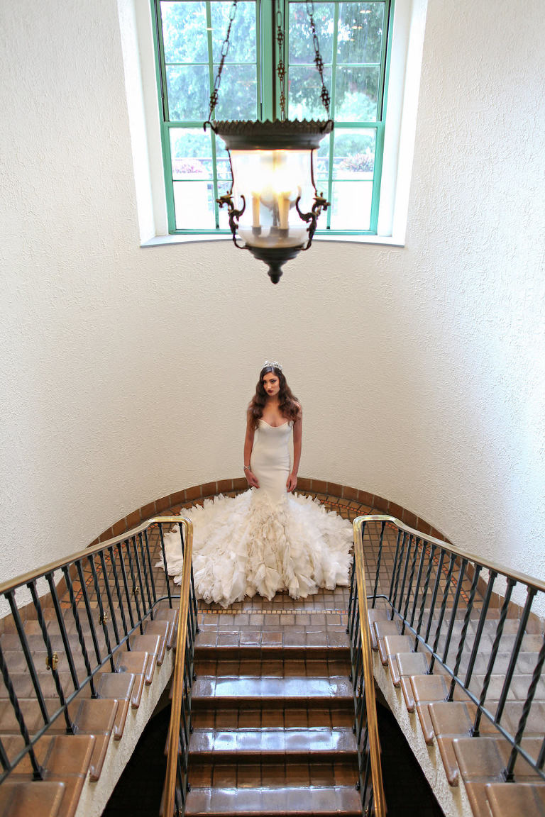 Bridal Indoor Staircase Portrait in Layered Mermaid Ines Di Santo Strapless Wedding Dress | St Petersburg FL Historic Venue Vinoy Renaissance
