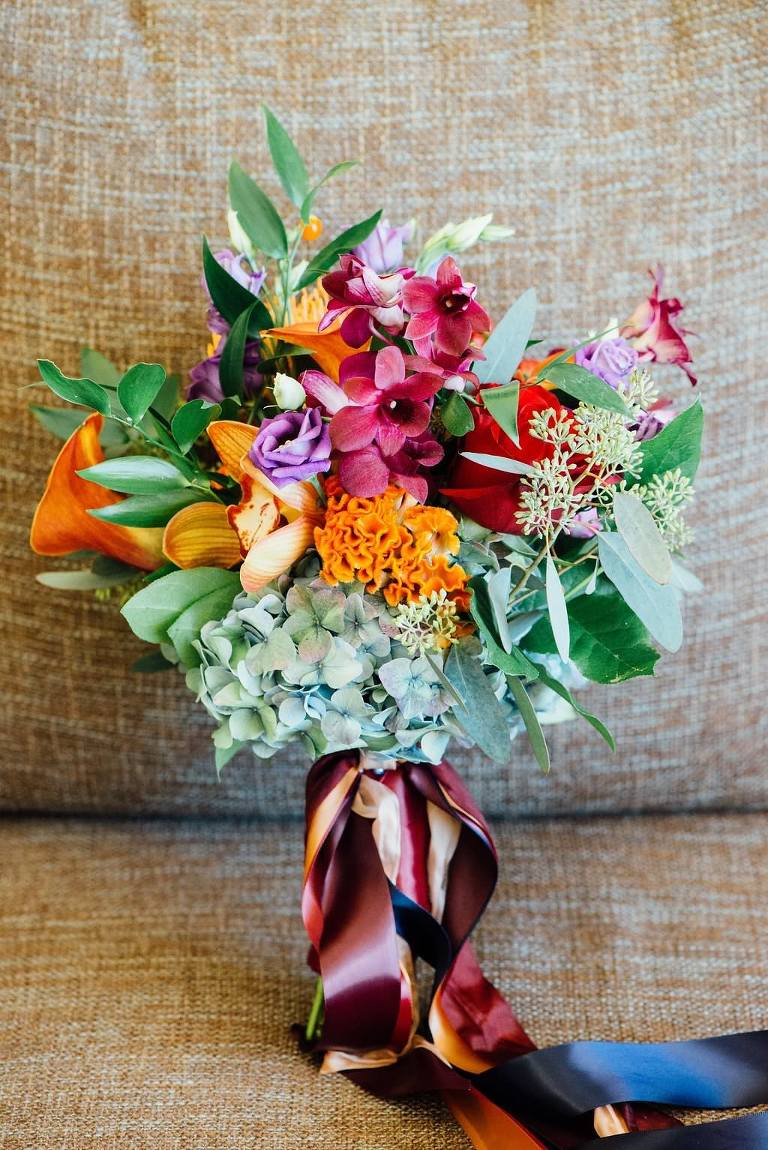 Orange, Red, Purple and Greenery Wedding Bouquet with Jewel Tone Ribbons