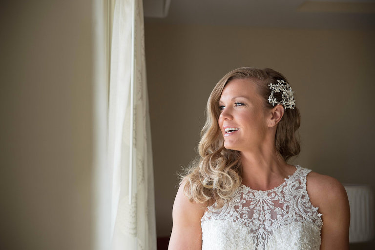 Interior Bride Getting Ready Portrait wearing Essence of Australia Embroidered Illusion Neckline Wedding Dress with Silver Floral Hair Accessory | Tampa Bay Wedding Photographer Kristen Marie Photography