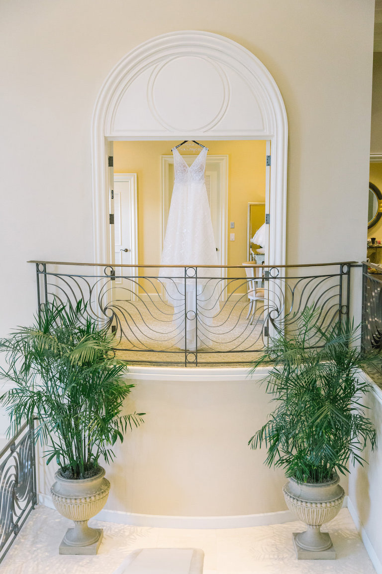 Calla Blanche V Neck A Frame Wedding Dress on Hanger at Tampa Bay Wedding Venue Lakewood Ranch Golf & Country Club