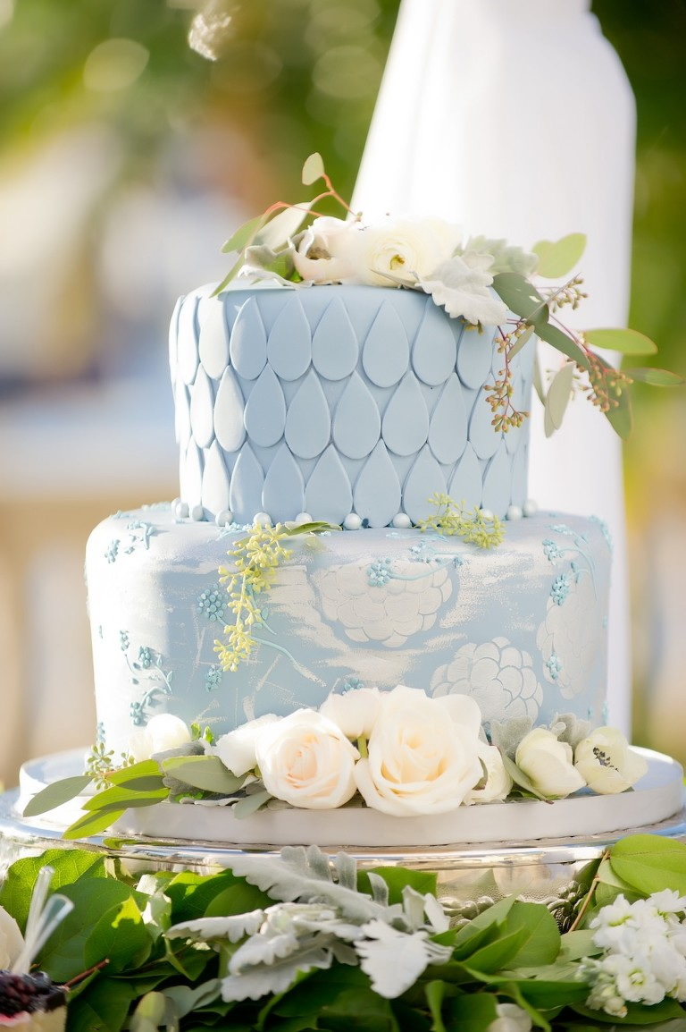 Two Tiered Hand-painted Light Blue and White Wedding Cake with White Floral Cake Topper with Greenery on Silver Cakestand for Outdoor French Countryside Inspired Wedding   Tampa Bay Wedding Cake and Dessert Bakery Alessi Bakery