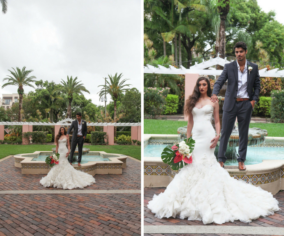 Outdoor Hotel Garden Wedding Portrait, Bride in Layered Mermaid Ines Di Santo Strapless Wedding Dress with Pink and White Lily with Green Fern Tropical Bouquet, Groom in Gray Suite with Boutonniere   St Petersburg FL Historic Venue Vinoy Renaissance