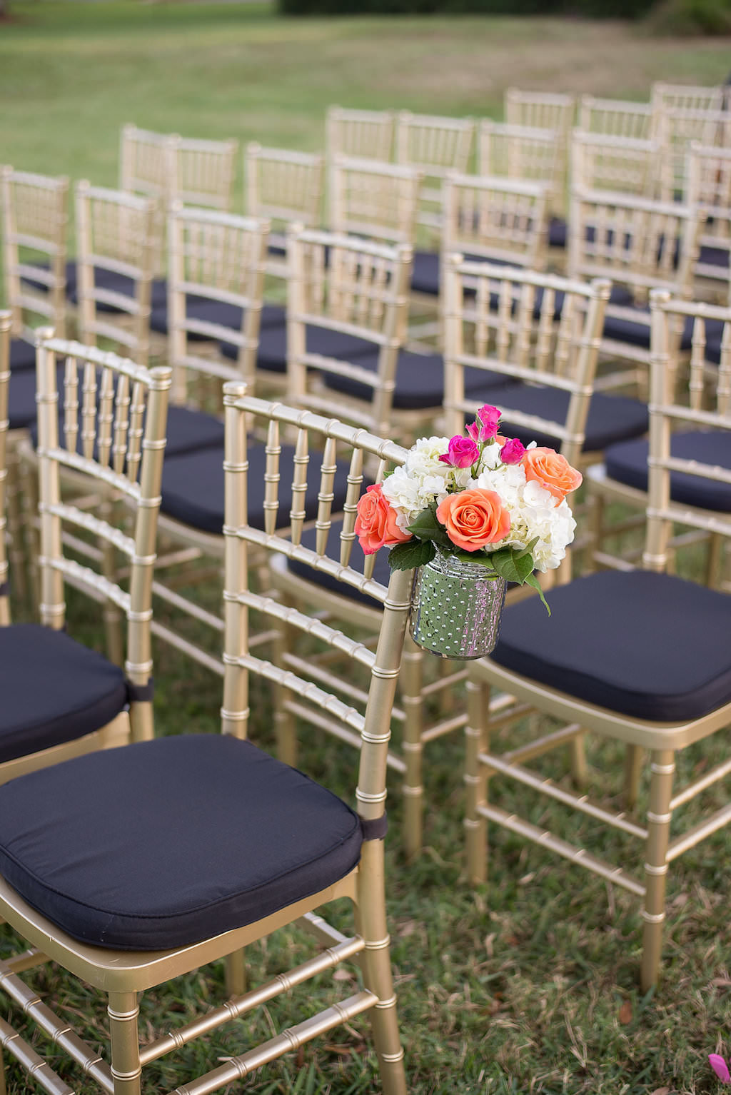 Outdoor Tropical Old Florida Themed Wedding Ceremony With Gold Chiavari Chairs With Black Cushions And Orange Rose With White And Pink Flowers And Greenery In Vintage Jar Decor Marry Me Tampa