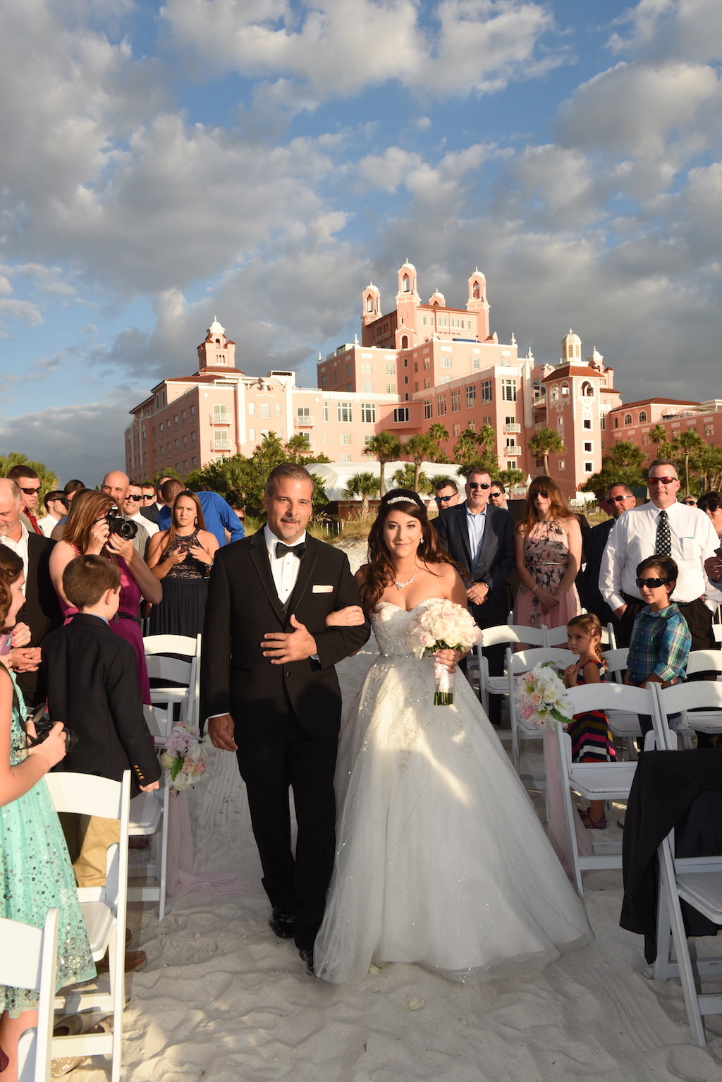 Fairytale Beach Wedding Ceremony Portrait, Bride in Strapless A Line Tulle Skirt Wedding Dress with White Rose Bouquet | St Pete Beach Hotel Wedding Venue The Don CeSar