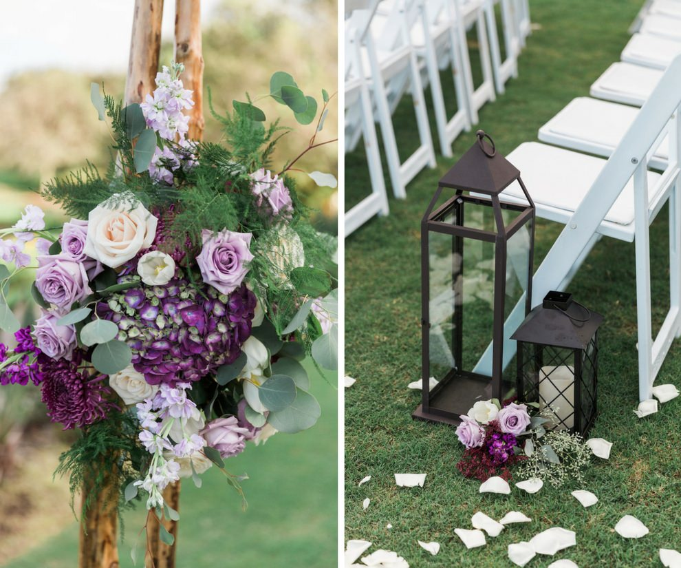 Whimsical Violet Outdoor Wedding Ceremony Decor with Tall Iron Lantern, White Folding Chairs, and Purple and White with Greenery Flower Arrangements