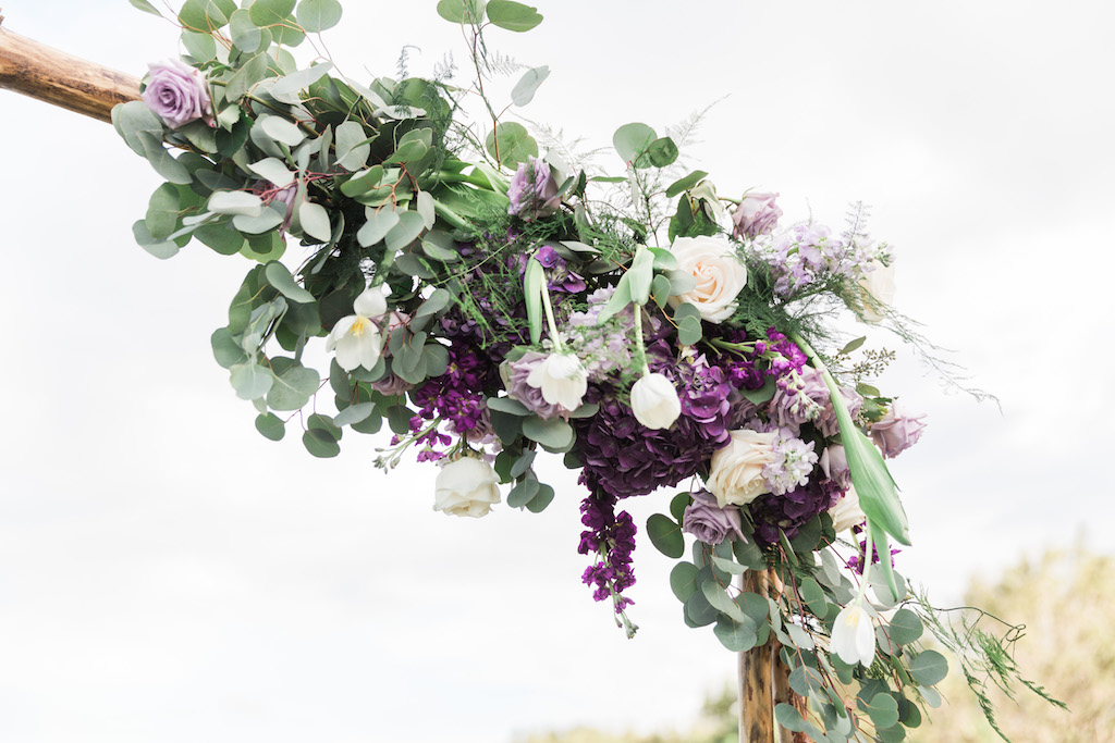 White, Lavender, Violet and Purple Flowers with Greenery Outdoor Ceremony Arch Decor