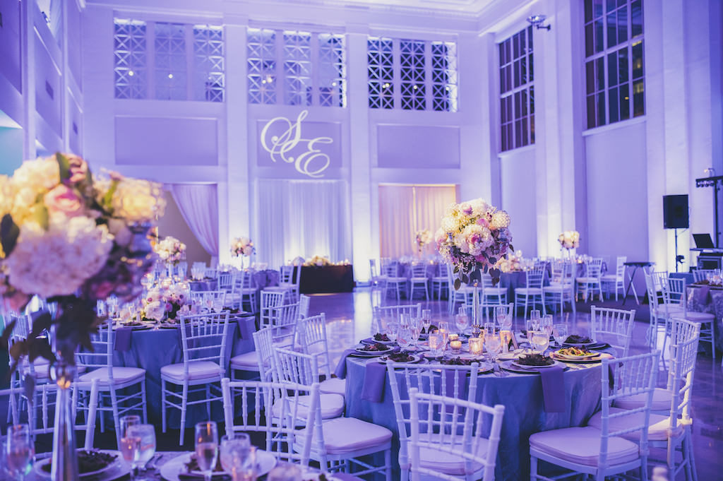 Modern Violet Wedding Reception with Tall White and PInk with Greenery Centerpieces in Silver Candelabras | Downtown Tampa Wedding Venue The Vault | Custom Monogram Lighting and Purple Uplighting by Nature Coast Entertainment | Planner Special Moments Event Planning
