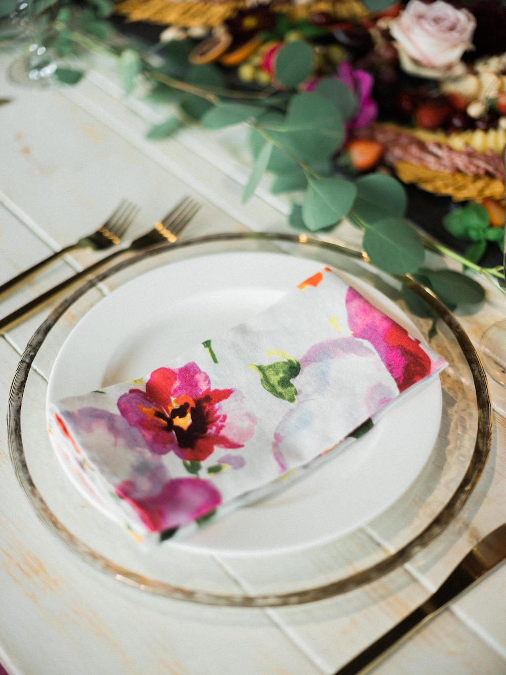 Modern Fuchsia Wedding Reception Table Setting with Watercolor Printed Napkin, Gold Flatware, Glass Charger   Dish and Charger Rentals by A Chair Affair
