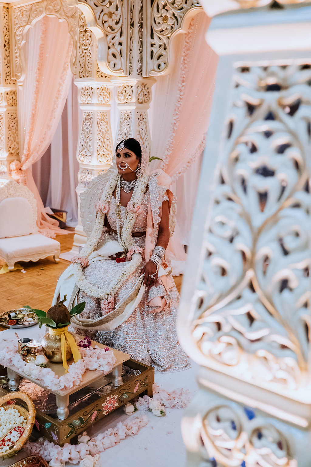 Regal and Romantic Traditional Hindu Indian Wedding Ceremony Bride Portrait with Gold Uplighting and Blush Pink Draping Behind the Mandap   Tampa Bay Wedding Venue Safety Harbor Resort and Spa   Planner Glitz Events   Photographer Grind and Press Photography