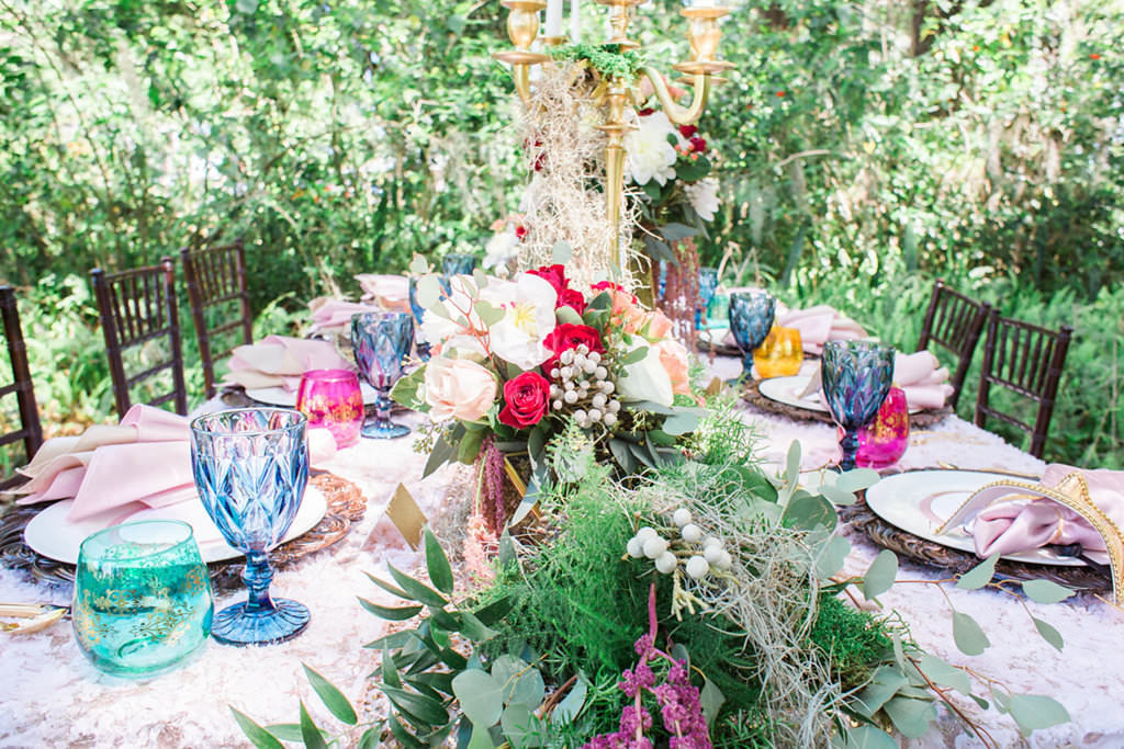 Outdoor Whimsical Boho Garden Wedding Reception Decor with Vintage Mismatched Dishes and Garland Floral Table Runner