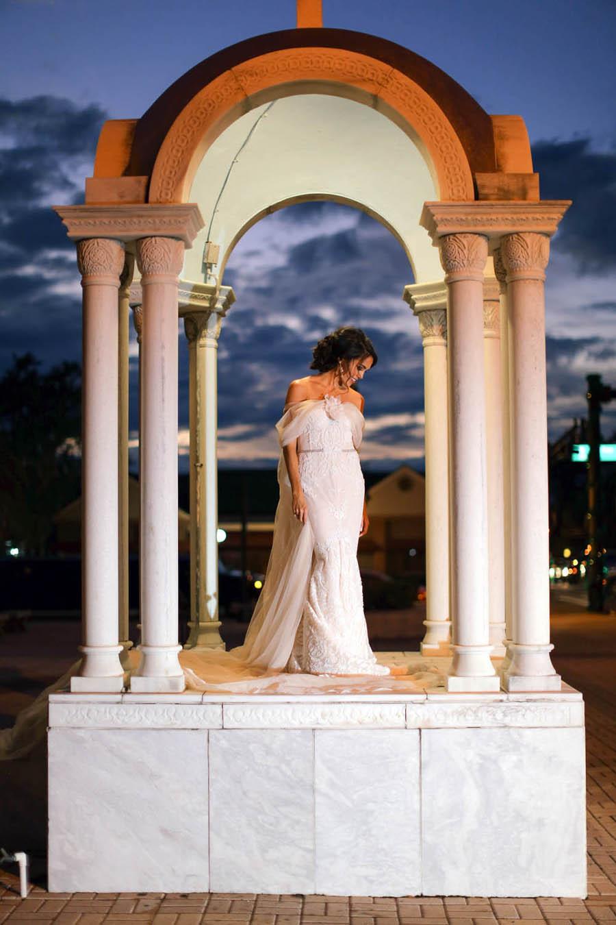 Outdoor Nighttime Greek Bridal Portrait with Columns in Inbal Dror Column Dress