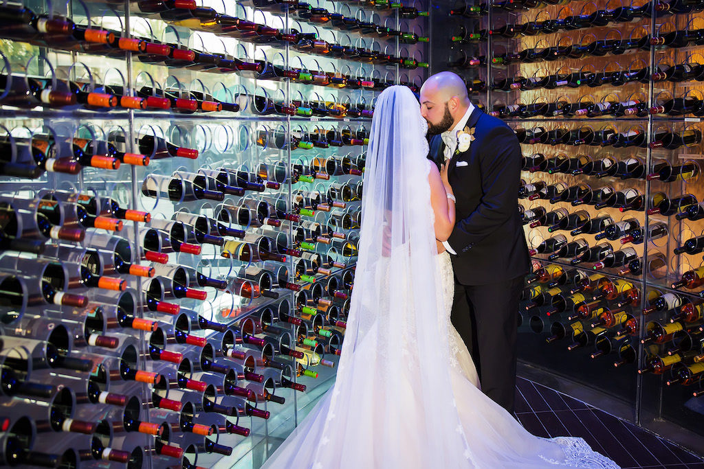 Bride and Groom Wedding Portrait in Wine Cellar, Bride in Cathedral Length Lace Trimmed Veil | Luxury Hotel Wedding Venue The Westin Tampa Bay