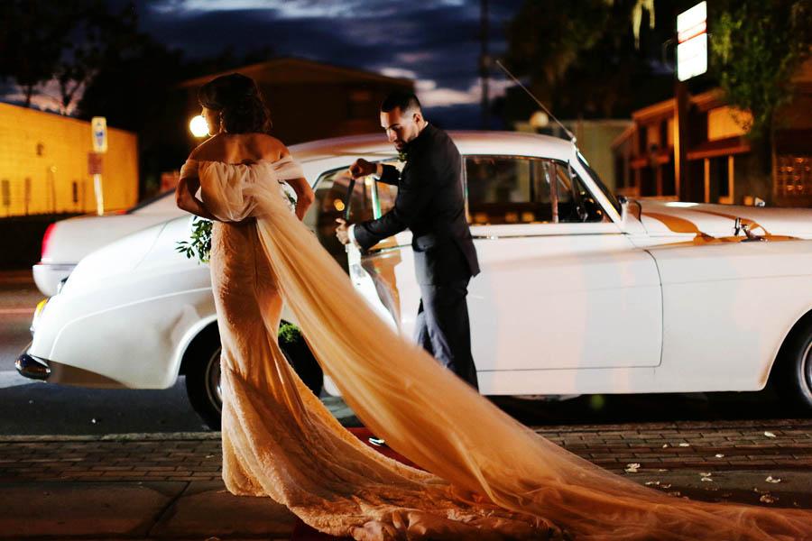 Outdoor Nighttime Wedding Portrait, Bride and Groom with Classic Car, Bride in Inbal Dror Wedding Dress
