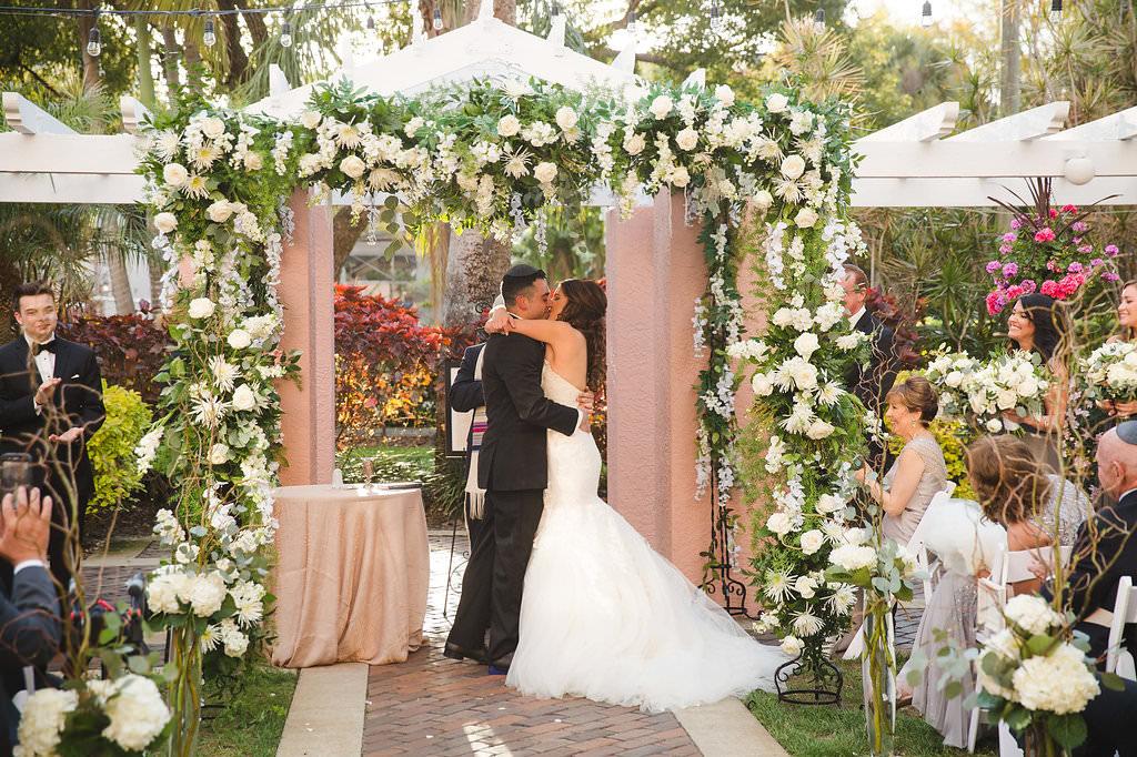 Outdoor Jewish Wedding Ceremony First Kiss Portrait Under White