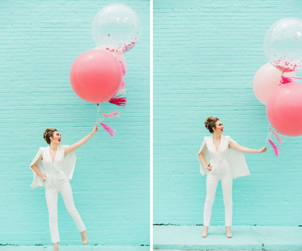 Modern Outdoor Bridal Portrait in White Lavish Alice Jumpsuit with Cape with Oversized Giant Balloons Filled with Pink Glitter   Modern Tampa Bay Wedding Venue Haus 820