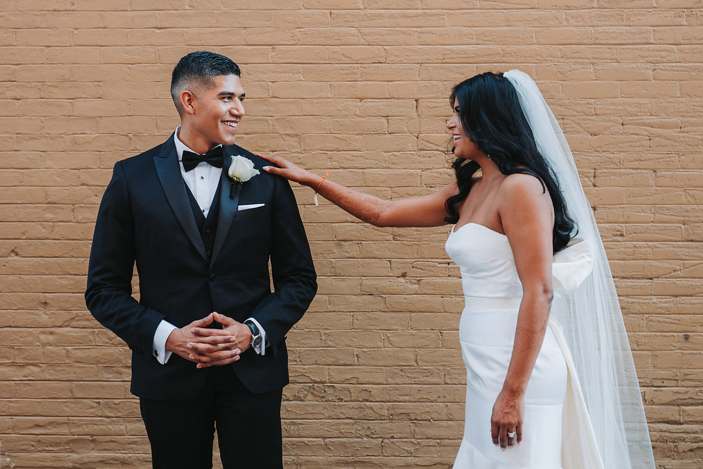 Modern Indian Wedding First Look Bride and Groom Portrait, Bride In Strapless Wedding Dress Groom in Black Tux With White Rose Boutonniere   Tampa Wedding Photographer Grind and Press Photography