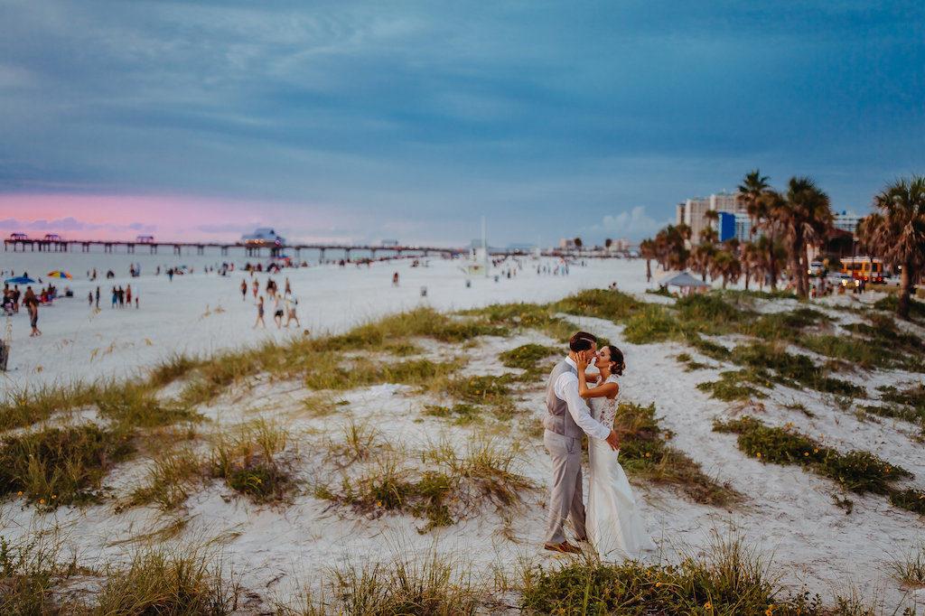 Outdoor Beach Sunset Bride and Groom Wedding Portrait, Bride in Lace Illusion Back Sincerity Bridal Wedding Dress, Groom in Gray Vest | Tampa Bay Wedding Photographer Rad Red Creative | Clearwater Beach Wedding Venue Hyatt Regency