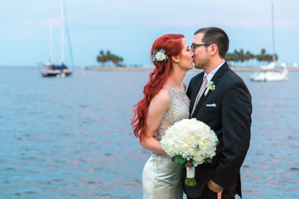 Outdoor Waterfront Downtown St. Pete Sunset Wedding Portrait, Bride with Floral Hair Accessory and Trumpet Allure Bridal Dress