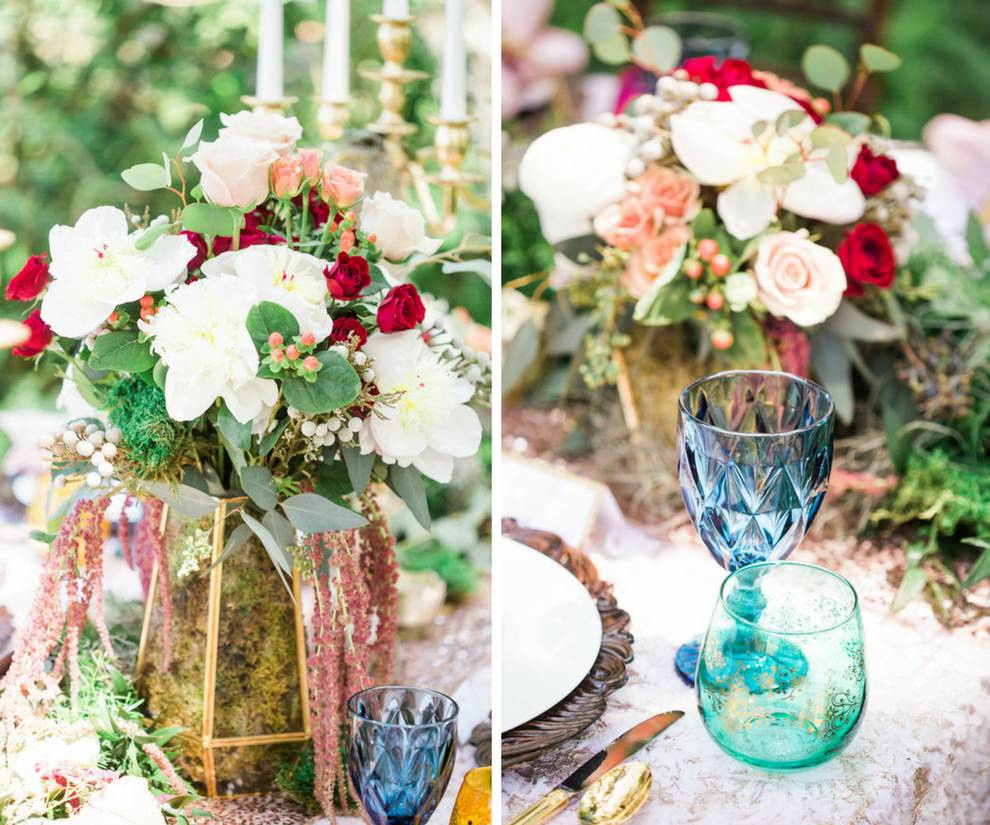 Outdoor Whimsical Boho Garden Wedding Reception Decor with Red and White Centerpiece in Geometric Vase with Moss and Vintage Blue Glasses