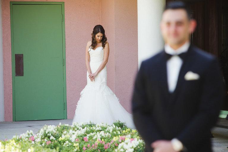Outdoor Garden First Look Wedding Portrait, Bride in Strapless Mermaid Lazaro Dress | Tampa Bay Photographer Marc Edwards Photographs | St Pete Historic Hotel Venue The Vinoy | Hair and Makeup Femme Akoi Studio