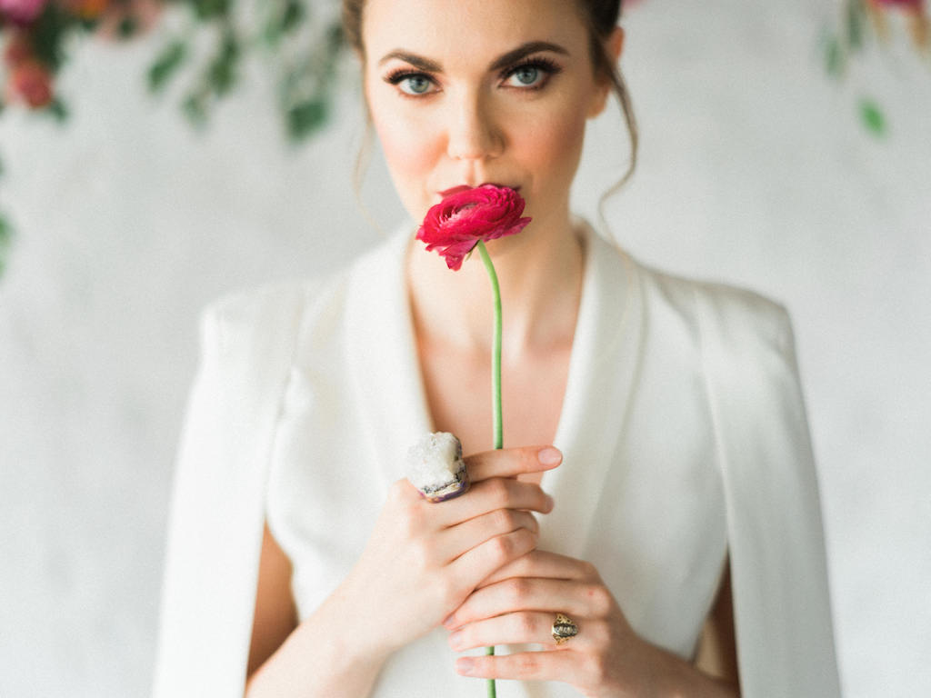 Modern Bride with Oversized Adina Mills Geode Ring wearing Lavish Alice White Jumpsuit with Cape