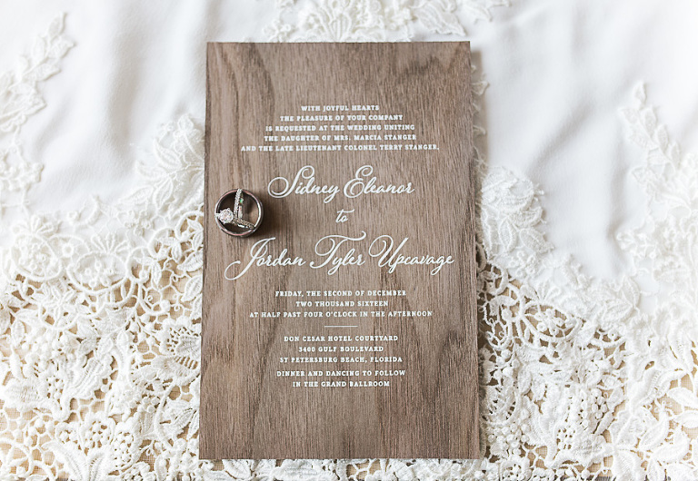 White Script Printed on Natural Wood Wedding Invitation with Engagement Ring and Wedding Band