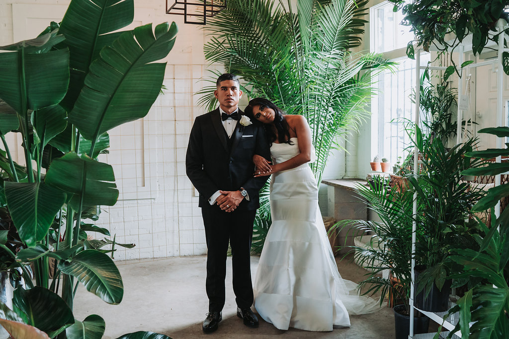 Modern Indian Wedding Bride and Groom Portrait, Bride in Strapless Mermaid Wedding Dress, Groom in Black Tuxedo with White Rose Boutonniere   Tampa Wedding Photographer Grind and Press Photography
