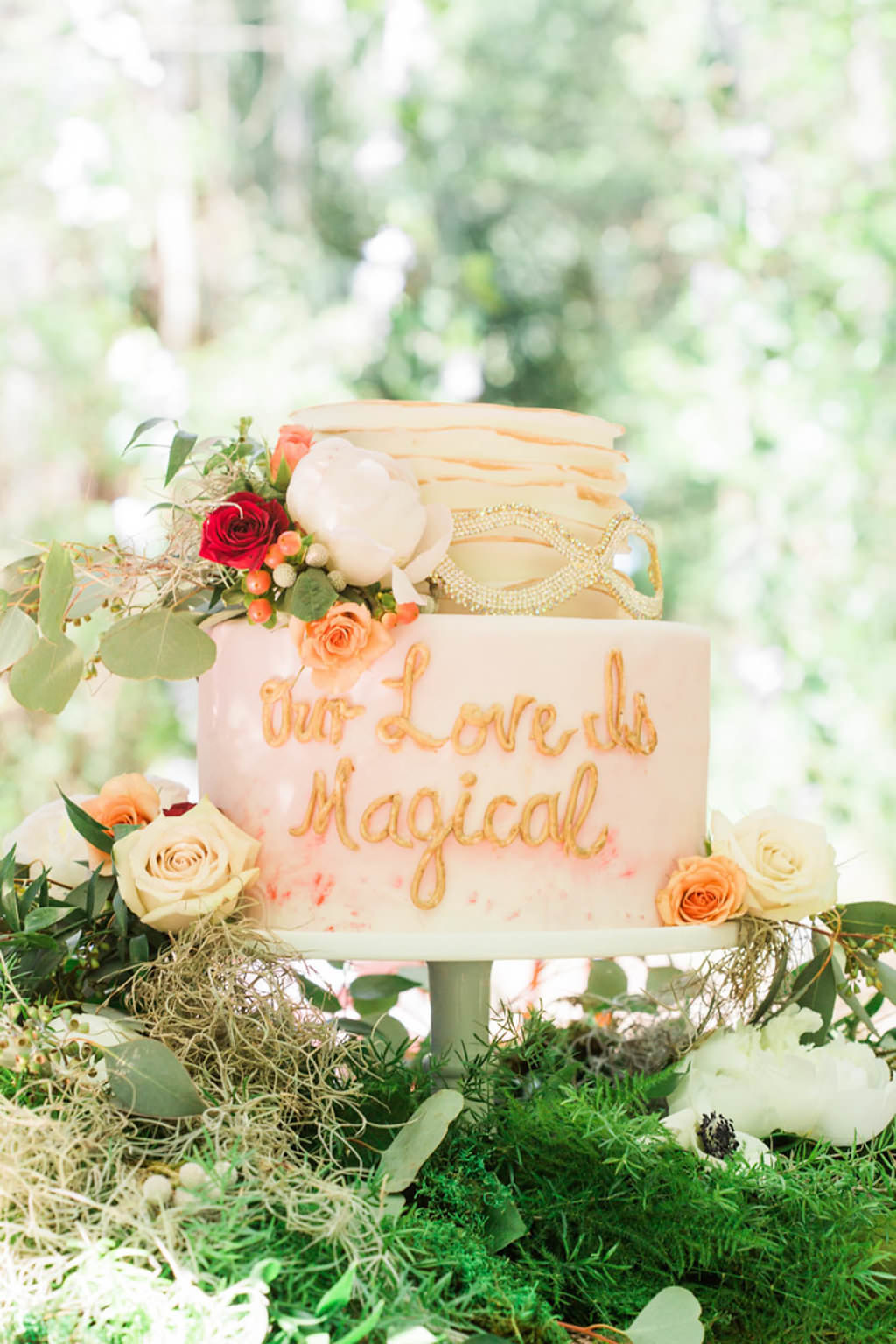 """Whimsical Rustic Two Tier Round Blush Pink Wedding Cake with """"Love Is Magical"""" Written"""