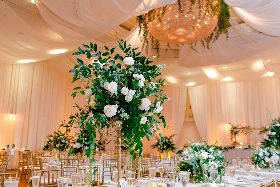 White Floral and Wild Natural Greenery Centerpiece in Gold Candelabra