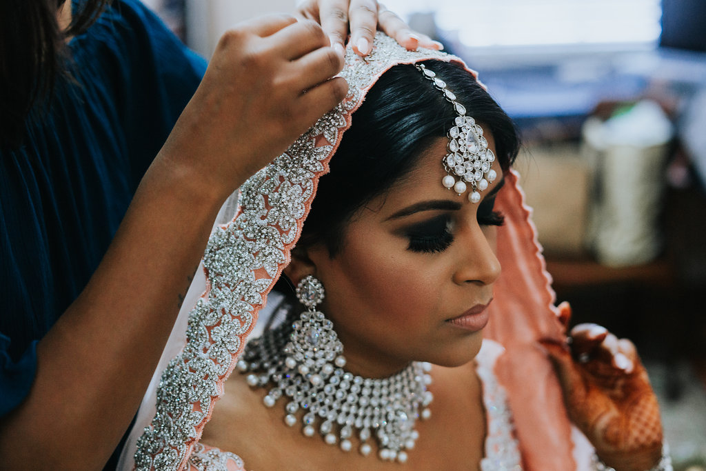Traditional Hindu Indian Wedding Bride Getting Ready Portrait in peach and Silver Saree   Tampa Wedding Photographer Grind and Press Photography