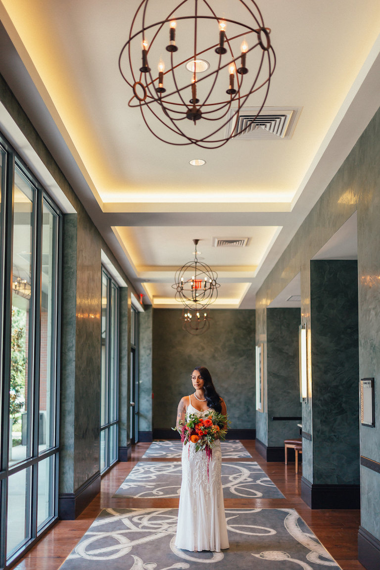 Hotel Interior Bridal Portrait in BHDLN Column Wedding Dress with Red, Orange and Greenery Bouquet | Tampa Boutique Hotel Wedding Venue The Epicurean