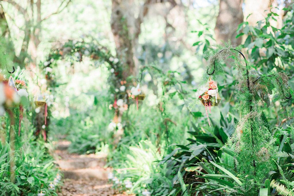 Outdoor Whimsical Garden Wedding Ceremony Inspiration With Geometric Vase with Moss on Shepherd Hooks