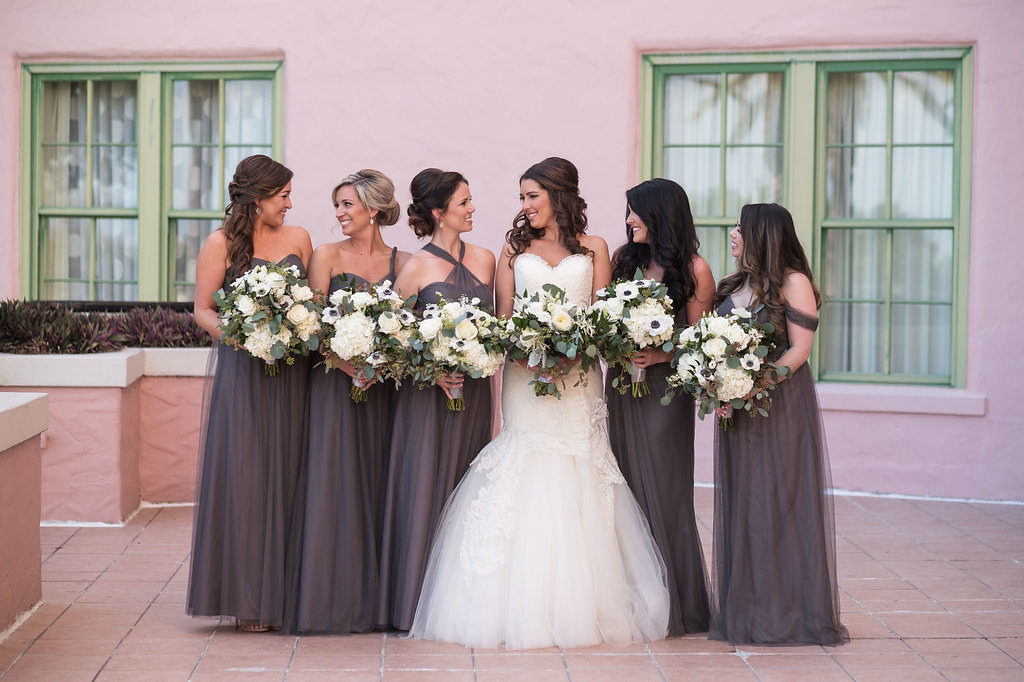 Outdoor Bridal Party Portrait, Bride in Strapless Mermaid Lazaro Dress, Bridesmaids in Mismatched Layered Mauve Jenny Yoo Dresses, with White FLoral and Anemone with Greenery Bouquet   Tampa Bay Wedding Photographer Marc Edwards Photographs   Hair and Makeup Femme Akoi Studio   St Pete Historic Hotel Venue The Vinoy