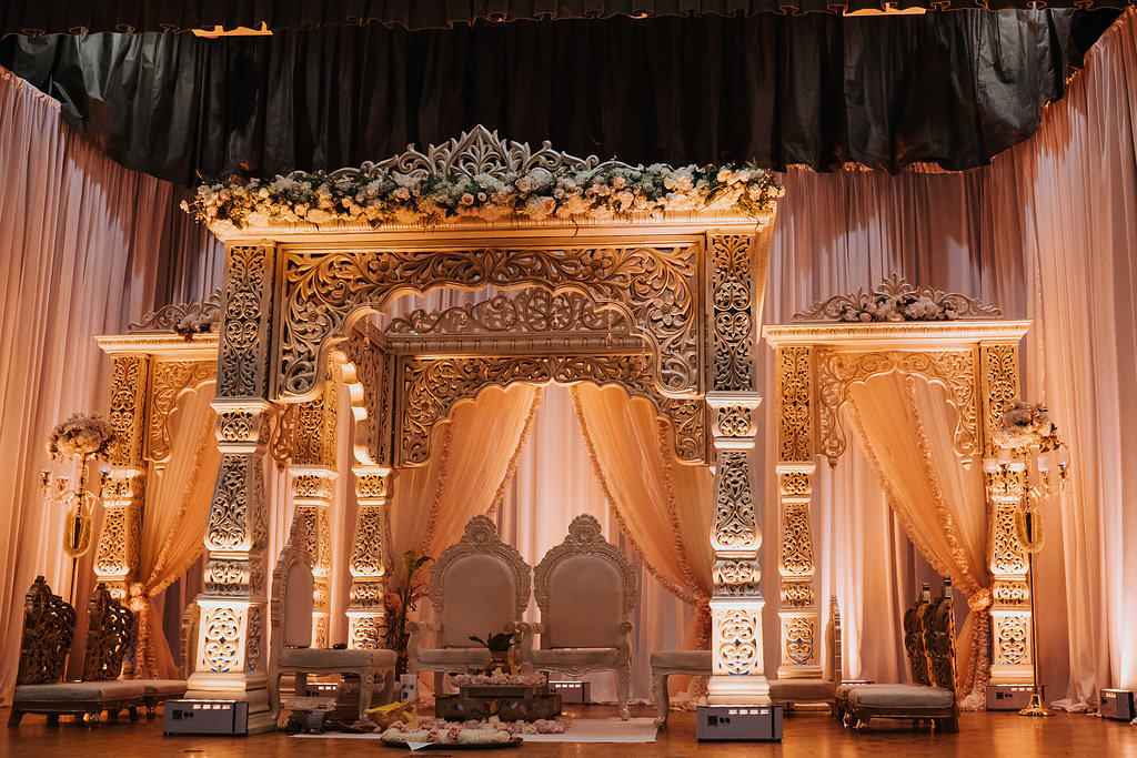 Regal and Romantic Traditional Hindu Indian Wedding Ceremony with Gold Uplighting and Blush Pink Draping Behind the Mandap   Tampa Bay Wedding Venue Safety Harbor Resort and Spa   Planner Glitz Events