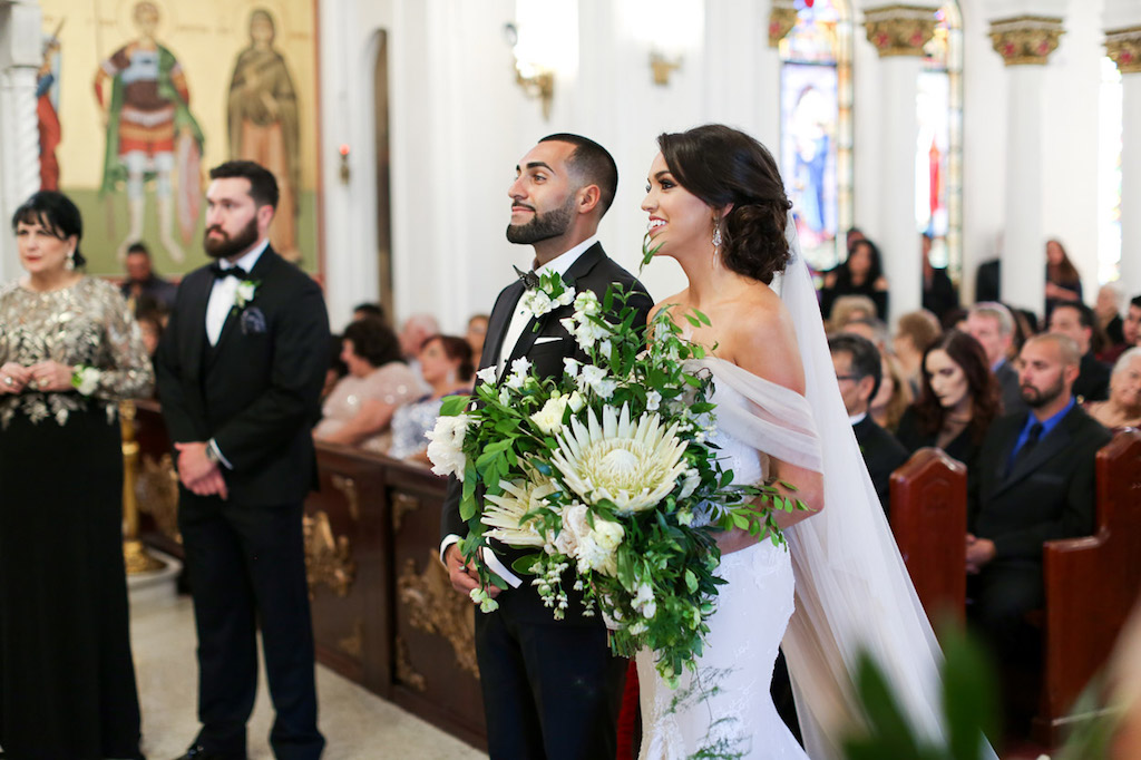 Greek Wedding Ceremony with Large Overside Wedding White and Green Wedding Bouquet   Tarpon Springs Traditional Wedding Venue St. Nicholas Greek Orthodox